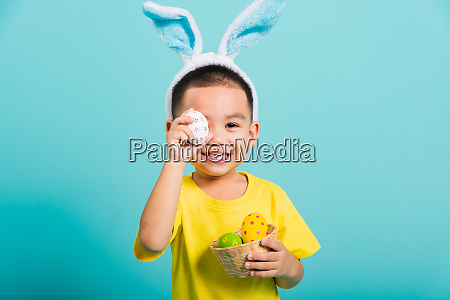 child boy wearing bunny ears and