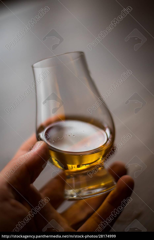 hand, holding, a, glencairn, whisky, glass - 28174999