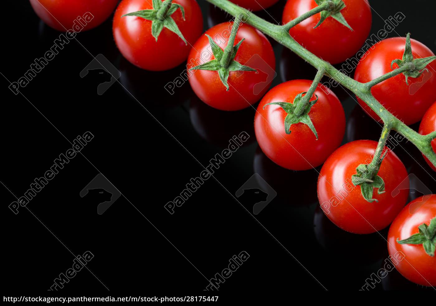 fresh, cherry, tomatoes, on, a, black - 28175447