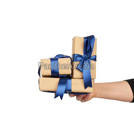hand, holds, a, stack, of, wrapped - 28175498