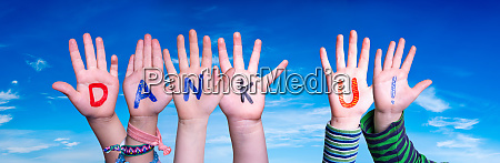 children hands building word dank u