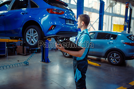 repairman with a checklist car service