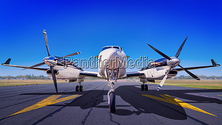 sports plane on a runway waiting