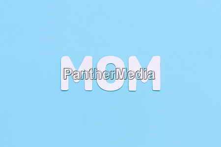 letters mom on a light blue