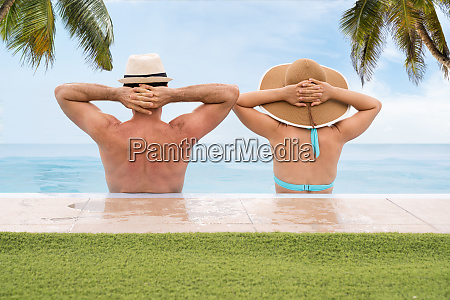 couple in infinite swimming pool