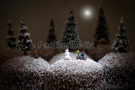 winter landscape children sledging on chocolate