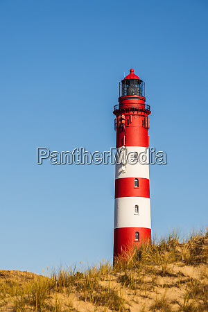lighthouse in front of blue sky
