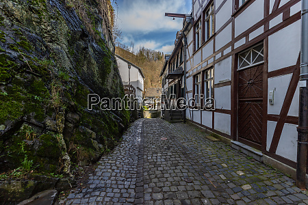 paved narrow road with half timbered