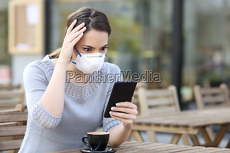 worried woman with mask looking at