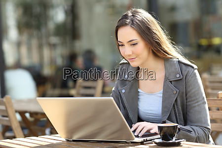 young woman using her laptop on