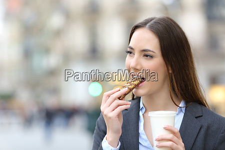 business woman eating a snack bar