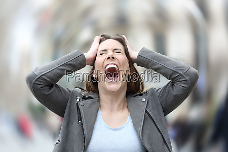 stressed woman suffering anxiety attack on