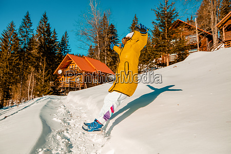 young woman leaping backwards into deep