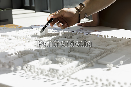close up of young architect pointing