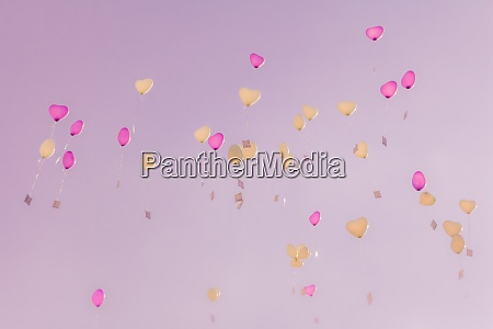 heart love balloons fly into pink