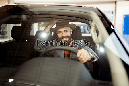 man checks the interior of truck