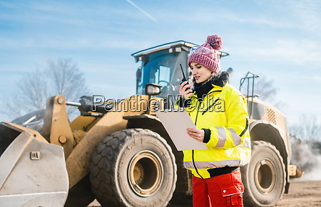 woman with walkie talky on compost