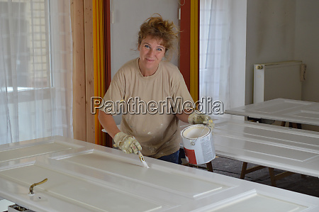 do it yourself woman painting doors