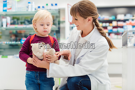 pharmacist woman with child customer and