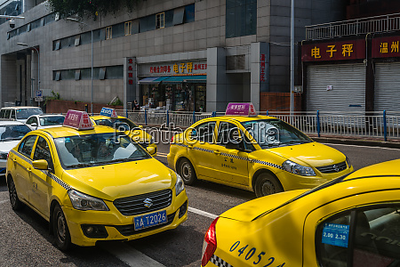 yellow taxis on the street in