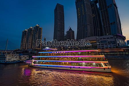 ship cruising in chongqing town at