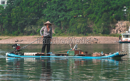 man on the bamboo boat crossing