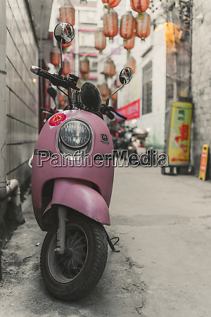 pink scooter parked in feng huang