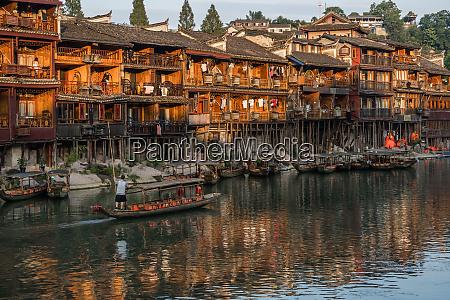 old wooden boat in fenghuang