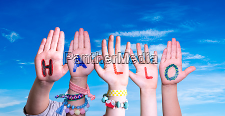 children hands building word hallo means