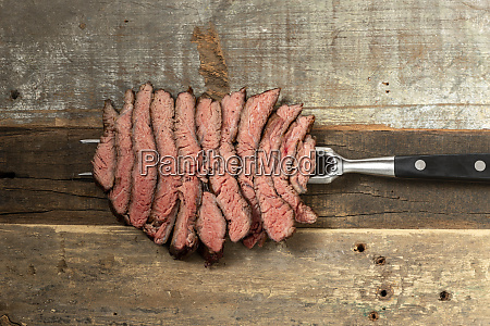 slices of a steak on wood