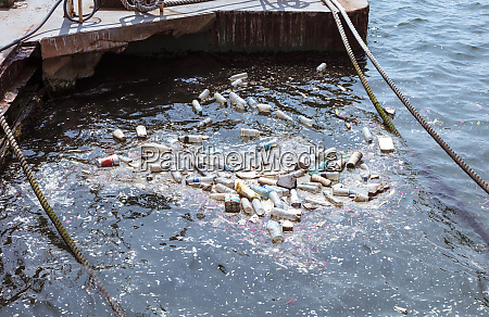 plastic bottles bags wastes floating in