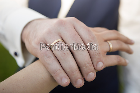 bridal couple with wedding rings