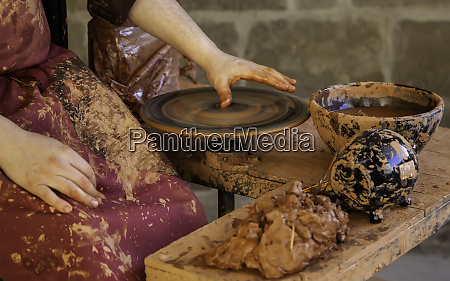 potter shaping the clay