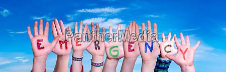 children hands building word emergency blue