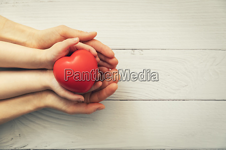 red heart in child and adult