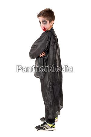kid in halloween costume