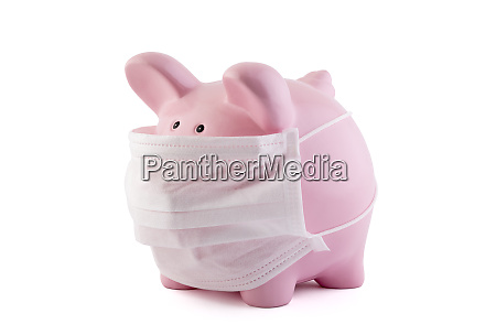 pink piggy bank with protective medical