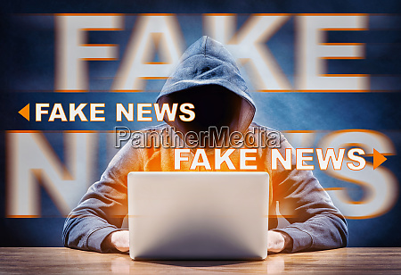 a hacker spreading fake news from