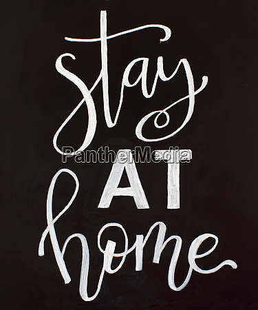 chalk inscription stay at home on