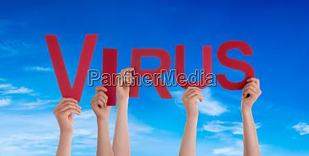people hands holding word virus blue