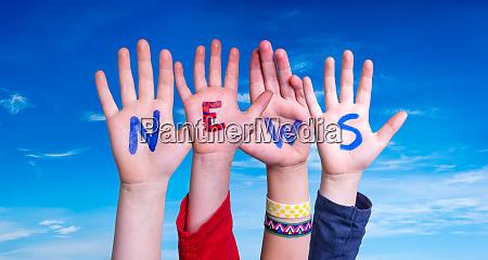 children hands building word news blue