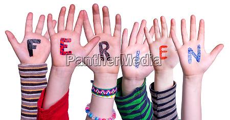 children hands building word ferien means