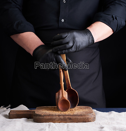chef in black latex gloves and