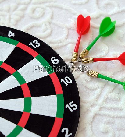 expressing success with dart arrows success