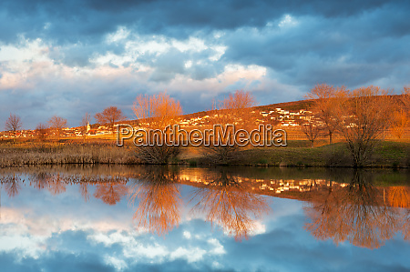 reflections of a village in a