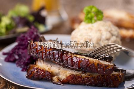 portion of fresh roasted pork on