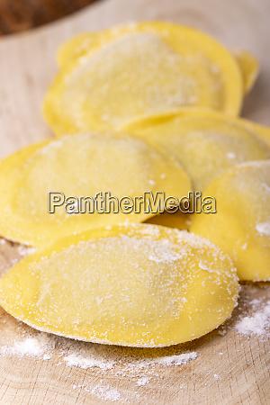 raw italian tortelli pasta with flour