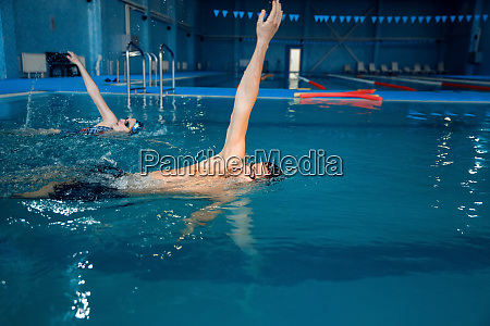 male swimmer swims in the pool