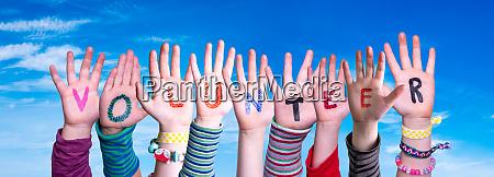 children hands building word volunteer blue