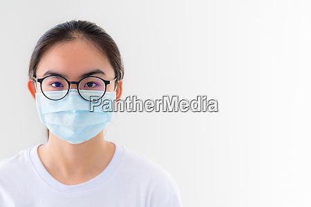 closeup face woman wearing mask anti
